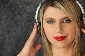 Blond woman with old-style headphones