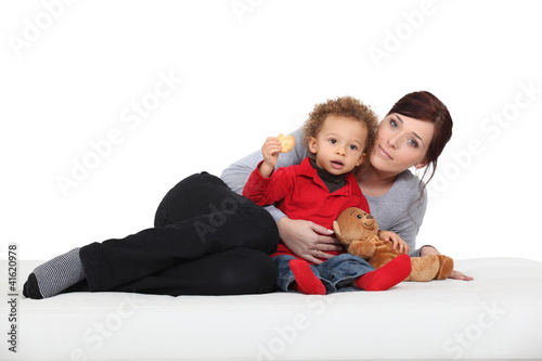 portrait of mother posing with mixed-race son