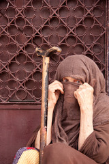 lady covering face with head scarf in Morocco