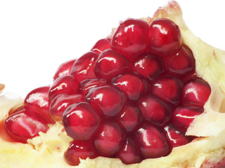 Extreme close up background of a red juicy ripe pomegranate frui
