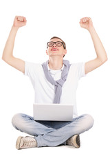 A man working with a laptop on the floor,hands up
