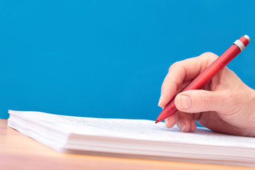 Hand with Pen Proofreading a Manuscript any Language