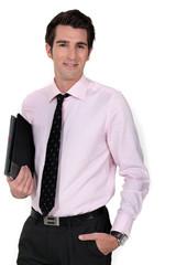 A businessman carrying a folder.