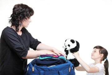 woman and daughter hand crammed full of clothes and shoulder bag