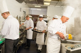 Professional kitchen busy team cooks and chef