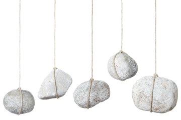 Stone hanging by a string on white, clipping path included