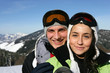 young couple and snowy mountains in background