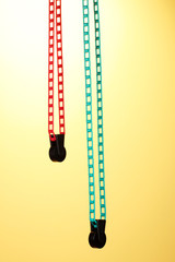 Lifting chain for studio background on yellow background