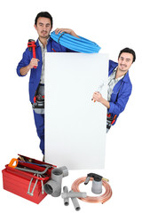 Plumber with a board left blank for your message