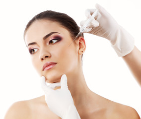 beautiful young woman face with beauty treatment  isolated on wh