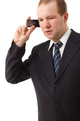 young businessman speaking mobile phone