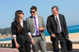 Business team having a walk outdoors.