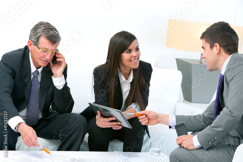 Business people at meeting.