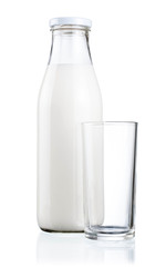 Bottle of fresh milk and blank glass isolated on a white backgro