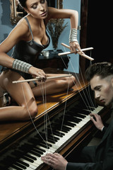 Seductive woman on the piano