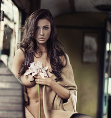 Sensual lady with a flower