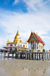 a  temple in the sea with sky background,Wat Hong Thong.