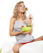 Healthy lifestyle - smiling woman with vegetable salad on white