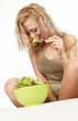 Woman with salad isolated on white