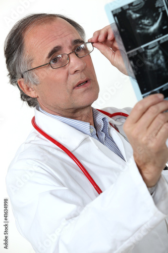 Medical doctor examining an x-ray