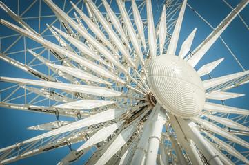 ferris wheel detail against a gradient blue sky