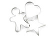 Star, gingerbread and heart pastry cutters on white.