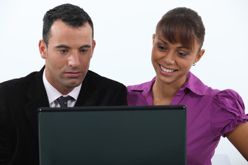 Colleagues in front of a laptop computer