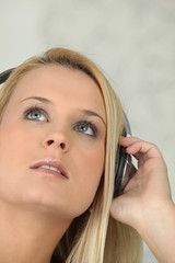Teen blonde with audio headphones