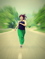 happy, cheerful girl running down the road