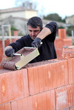 Builder laying blocks