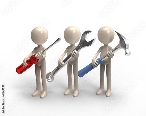 team of repairmen with tools