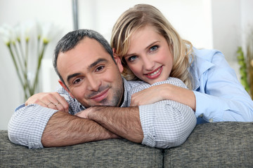 Couple relaxing on sofa