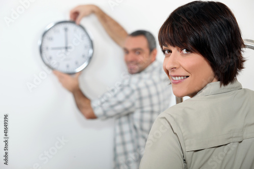Couple hanging clock