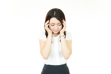 頭痛を訴えるオフィスレディー