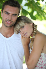 Blond woman leaning on man's shoulder