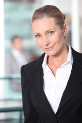 Close-up portrait of blond businesswoman