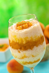 Fresh homemade rice pudding with peach compote