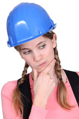 portrait of female apprentice looking puzzled