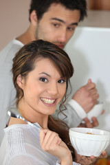 Couple eating breakfast cereal