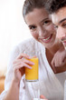 Couple drinking fruit juice