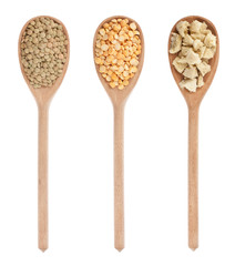 lentils, peas, soy  in three wooden spoons