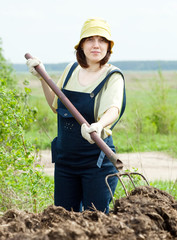 Woman works with animal manure