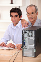 Grandfather and grandson with computer