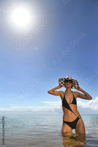 Woman in a bikini and polka dot hat