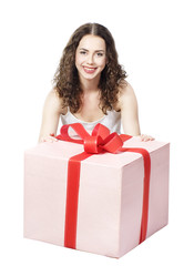Beautiful girl smiling holds a gift in a box