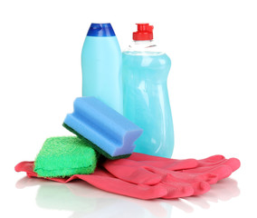 Dishwashing liquids with gloves and sponges isolated on white