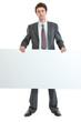 Full length portrait of businessman holding blank billboard
