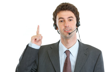Modern business operator with headset got idea