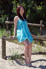 Asian girl with a light blue dress in the dunes 1