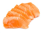 Isolated raw sliced salmon